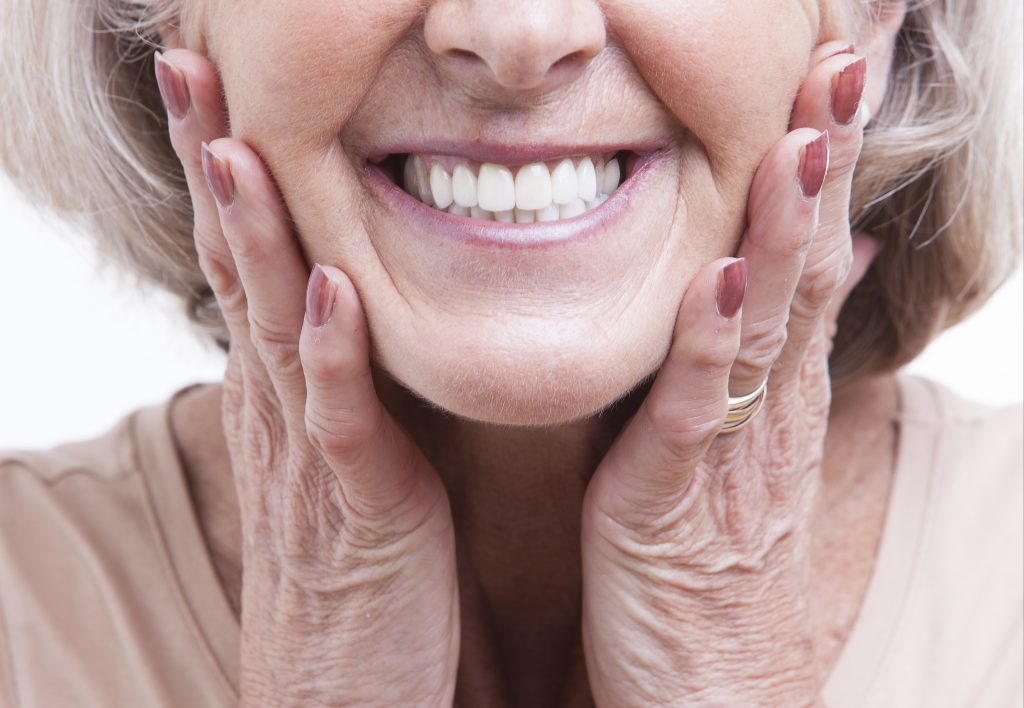 Photo of a woman with dentures smiling