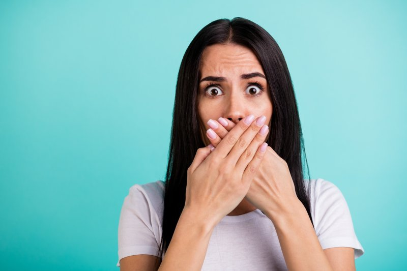 woman in shock covering her mouth