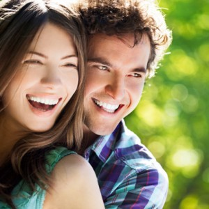 couple with great teeth thanks to the cosmetic dentist burlington loves complete dental care