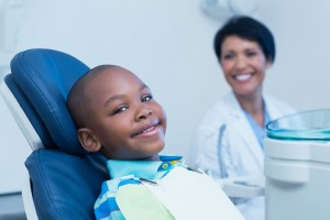 Young boy smiling at dentists burlington trusts