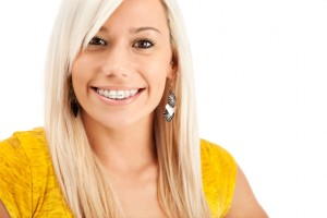 Woman using six month smiles for improved oral health