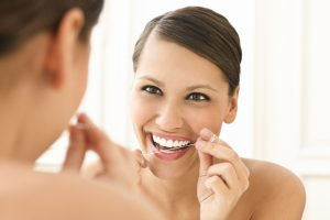 For a healthier smile, the dentist in Burlington recommends flossing at least once a day.